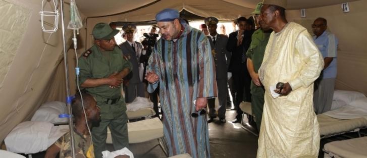الملك محمد السادس يزور المستشفى العسكري الميداني المغربي رفقة الرئيس الغيني
