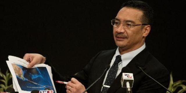 قمر اصطناعي يرصد 122 جسما في منطقة البحث عن الطائرة الماليزية