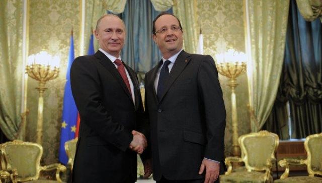 بوتين وهولوند في محادثات حول الأزمة الأوكرانية