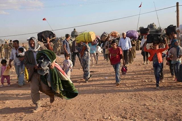100  ألف كردي سوري فروا من