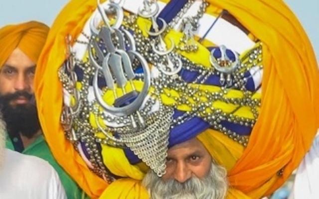 هندي يرتدي عمامة وزنها 55 كيلو وطولها 600 متراً