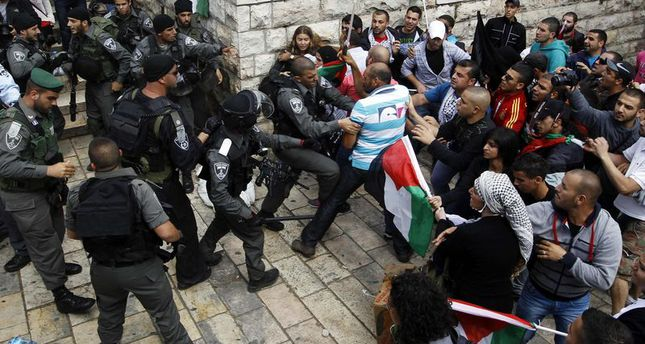 Palestinian protestors clash with Israeli security forces during clashes near Damascus Gate at Jerusalem's old city