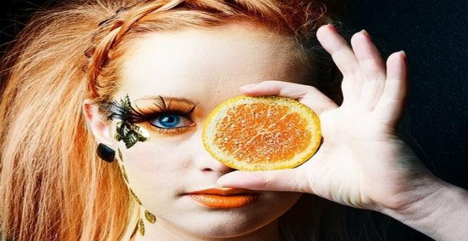 استعيني باللون البرتقالي لإطلالة مشرقة في الصيف