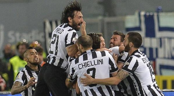 Juventus' forward Alessandro Matri (hidden) celebrates with teammates after scoring during the Italian Tim Cup final match (Coppa Italia) between Juventus and Lazio on May 20, 2015 at the Stadio Olimpico in Rome.      AFP PHOTO / ANDREAS SOLARO        (Photo credit should read ANDREAS SOLARO/AFP/Getty Images)