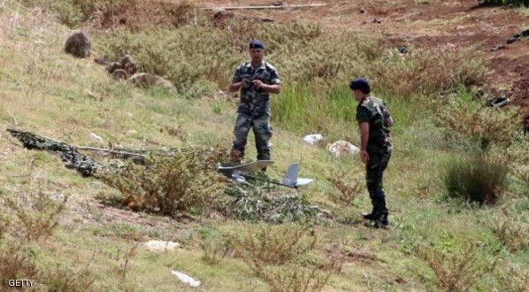 Lebanese army soldiers inspect the wreckage of an Israeli drone that crashed along the southern Lebanese border with Israel, on September 20, 2014. An Israeli drone crashed inside Lebanon, coming down close to the demarcation line with the Jewish state, a military source. AFP PHOTO/ALI DIA        (Photo credit should read ALI DIA/AFP/Getty Images)