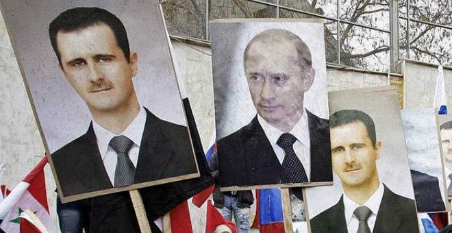 بوتين مازال متمسكا بالأسد ويحذر من الإطاحة به