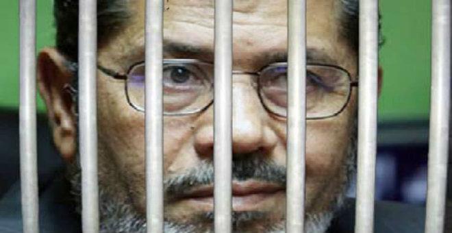 حكم بالمؤبد على مرسي والإعدام للبلتاجي والشاطر