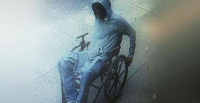 لصّ على كرسي متحرك يسرق بنكاً ويهرب