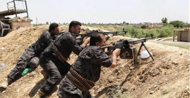 الأكراد ينتزعون بلدة تل أبيض من قبضة داعش