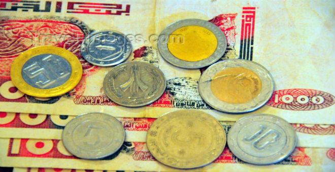 استمرار تراجع الدينار الجزائري إلى مستويات قياسية