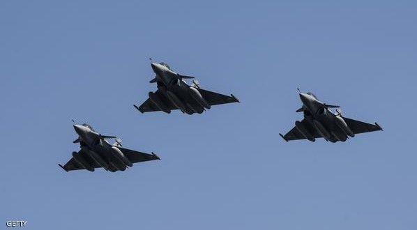 Three French made Rafale fighter jets fly with other Egyptian air force warplanes (unseen) above Cairo, on July 21, 2015. Egypt took delivery of three Rafale fighter jets from France, the first of 24 warplanes sold in a 5.2 billion euro ($5.6 billion) deal earlier this year. AFP PHOTO / KHALED DESOUKI        (Photo credit should read KHALED DESOUKI/AFP/Getty Images)
