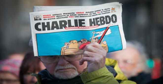 بالصور..شارلي إيبدو تسخر من أزمة اللاجئين