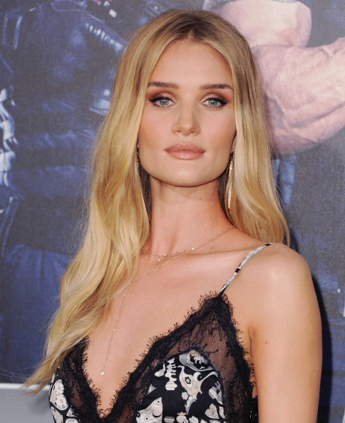"HOLLYWOOD, CA - AUGUST 11:  Model Rosie Huntington-Whiteley arrives at the Los Angeles Premiere ""The Expendables 3"" at TCL Chinese Theatre on August 11, 2014 in Hollywood, California.  (Photo by Jon Kopaloff/FilmMagic)"