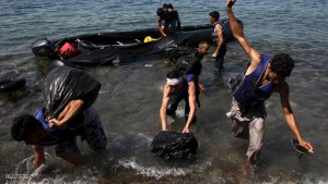 Afghan immigrants arrive on a dinghy on the Greek island of Lesbos after crossing a part of the Aegean Sea between Turkey and Greece, August 6, 2015. The U.N refugee agency, UNHCR, estimates that Greece has received more than 107,000 refugees and migrants this year, more than double its 43,500 intake of 2014. REUTERS/Yiannis Kourtoglou TPX IMAGES OF THE DAY
