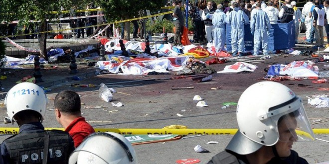ATTENTION EDITORS - VISUAL COVERAGE OF SCENES OF INJURY OR DEATHPolice forensic experts examine the scene following explosions during a peace march in Ankara, Turkey, October 10, 2015. At least 30 people were killed when twin explosions hit a rally of hundreds of pro-Kurdish and leftist activists outside Ankara's main train station on Saturday in what the government described as a terrorist attack, weeks ahead of an election. REUTERS/Stringer      - RTS3UFU