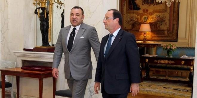 الملك محمد السادس والرئيس فرانسوا هولاند في لقاء سابق.