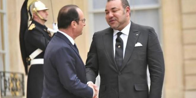sm_le_roi_s_entretient_a_paris_avec_le_president_francais-g2