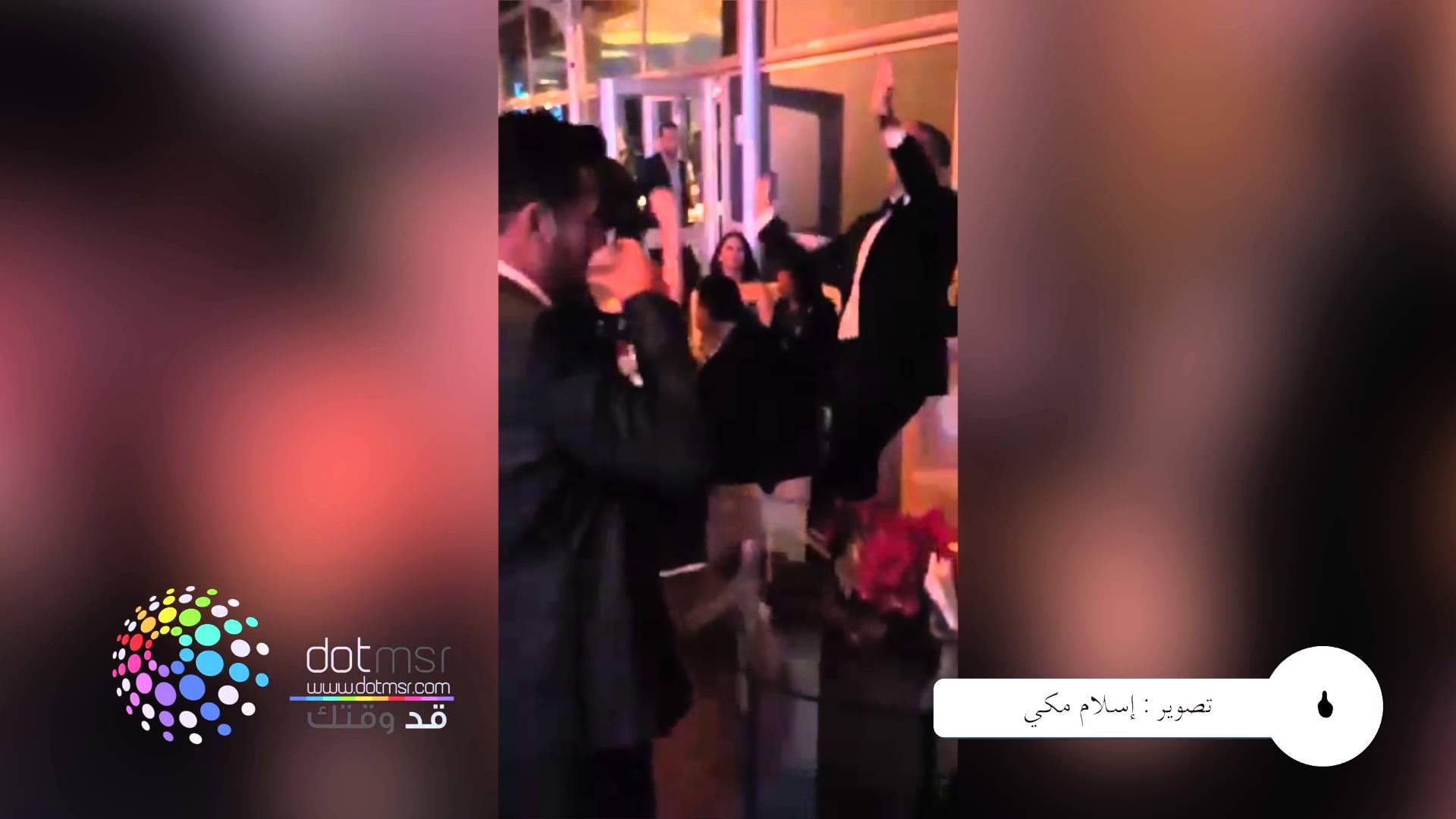 باسم يوسف ومنة شلبي يرقصان بجنون