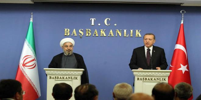 الرئيس التركي رجب طيب أردوغان ونظيره الإيراني حسن روحاني