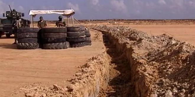 الجدار الرملي بين تونس وليبيا
