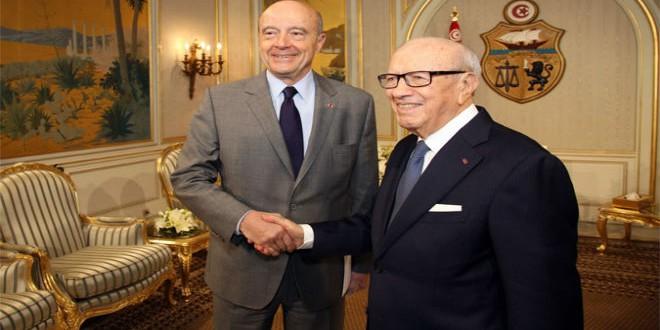 الرئيس التونسي الباجي قايد السبسي رفقة آلان جوبي