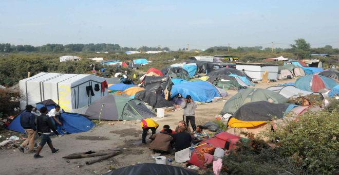 فرنسا: هولاند يريد فض مخيم كالي للاجئين