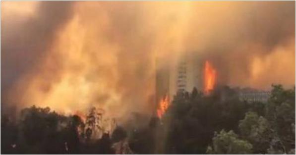 نيران جهنمية تلتهم عمارات كاملة بحيفا في إسرائيل