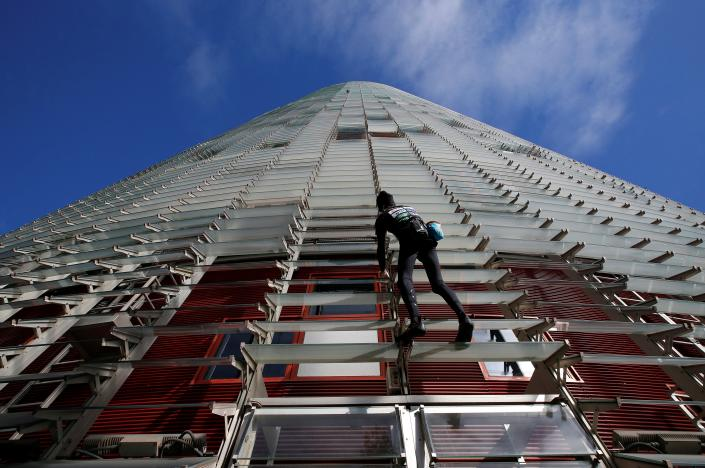 "French climber Alain Robert, also known as ""The French Spiderman"", scales the 38-story skyscraper Torre Agbar in Barcelona, Spain, November 25, 2016. REUTERS/Albert Gea"