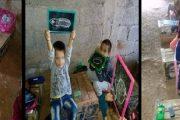 صور لأطفال يدرسون فوق صناديق خشبية تلهب