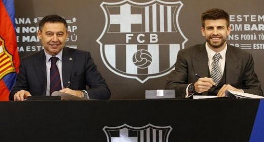 بيكيه يجدد عقده مع برشلونة