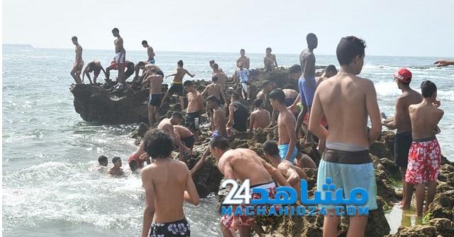 بالصور.. موجة الحر تدفع البيضاويين إلى الشواطئ في رمضان