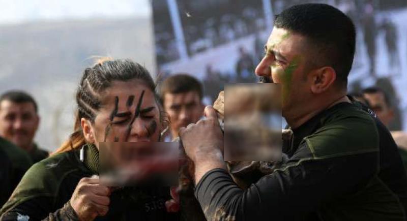 بتناول الثعابين والأرانب الحية.. تدريبات قاسية للكرديات لمواجهة داعش (صور)