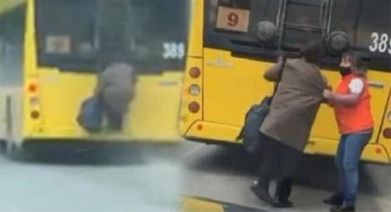 مسنة أوكرانية تتعلق بسلم الحافلة الخارجي بسبب قيود الحجر الصحي (فيديو)