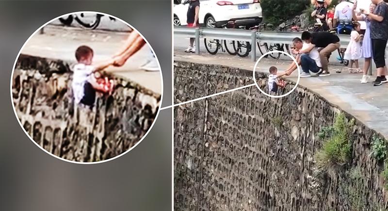 رجل يخاطر بحياة ابنه لالتقاط صورة (فيديو)