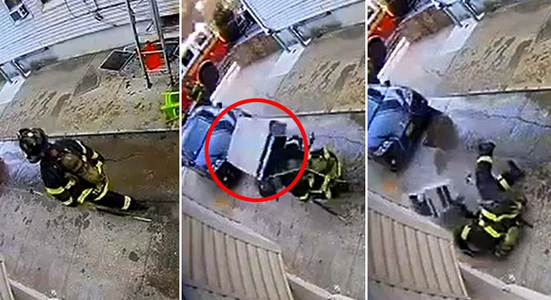 لحظات مروعة بعد سقوط مكيف هواء ثقيل على رجل إطفاء أثناء عمله (فيديو )