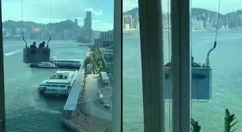 عمال يخاطرون بحياتهم لتنطيف نوافذ مبنى شاهق في يوم عاصف (فيديو)