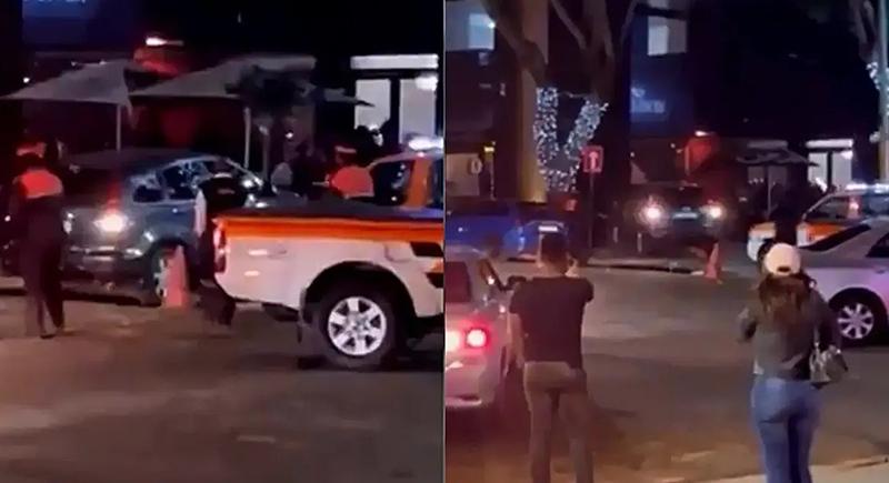 رجل يحاول دخول المطعم بالسيارة ليتحدث مع صديقته السابقة (فيديو)